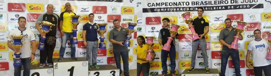 Professor Diogo Rocha no podium de campeão geral feminino e Professor Alessandro Nascimento Campeão geral masculino.